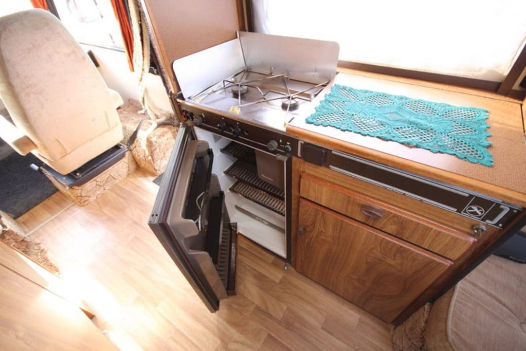 Gas stove  and fridge.