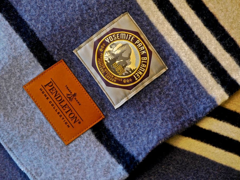 The blanket on the bed commemorates Yosemite National Park