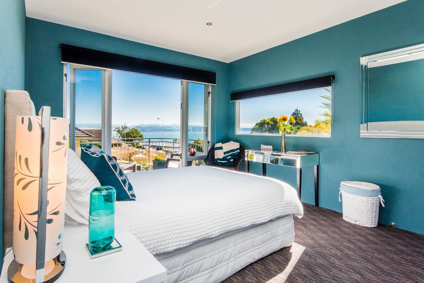 Bedroom One - fantastic views and sunshine. And doors open out to your deck.