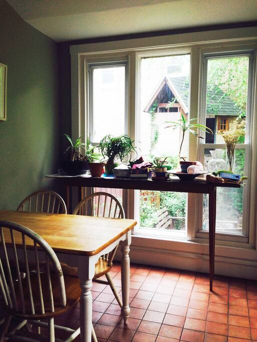 Sunny breakfast room overlooking garden. Great for morning coffee.