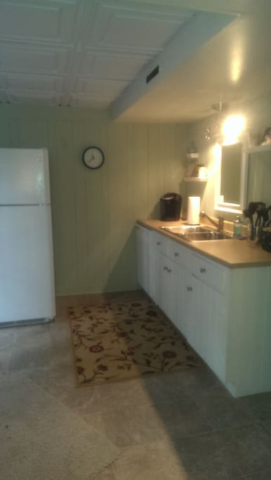 Kitchen Counter with Keurig and refrigerator