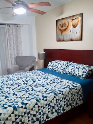 MASTER BEDROOM with access to patio. Has a hotel size safe located in the closet.  TV with cable (movistar)