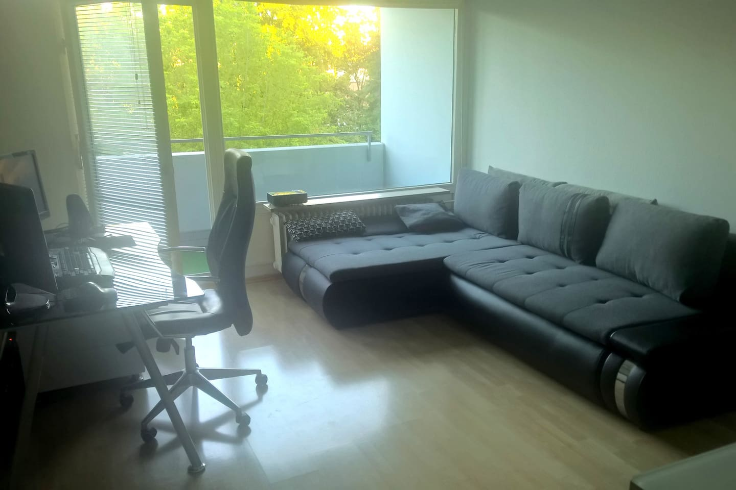 living room with couch and space for airbed