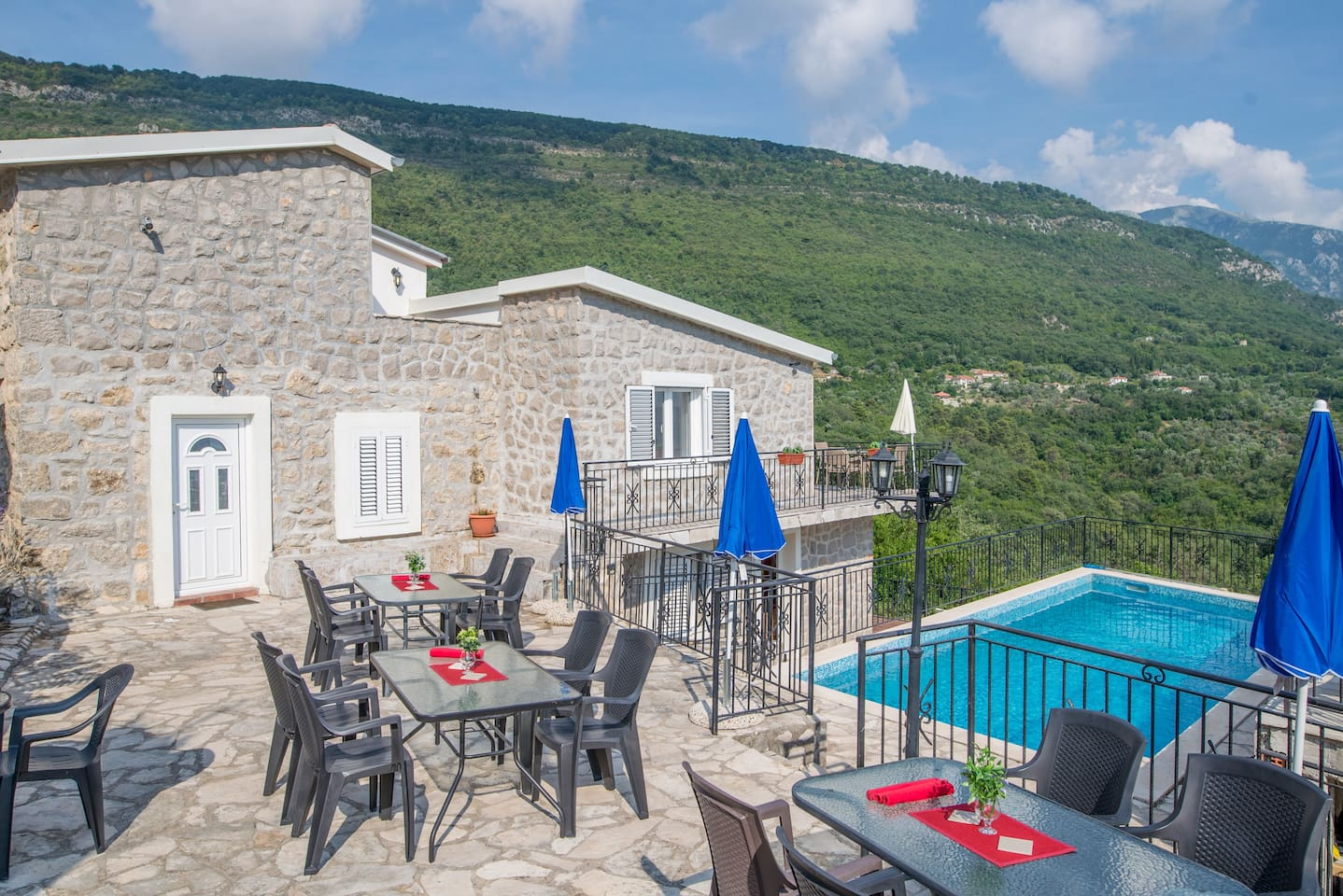 Palmagora apartments, pool and communal areas nestling among mountains