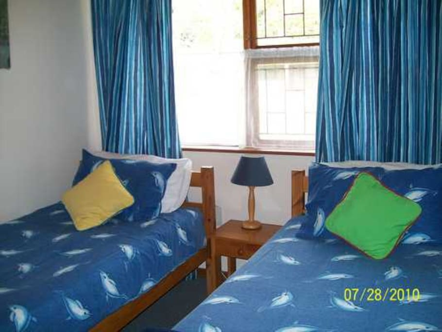 2 x twin bedrooms share a full bathroom, with bathtub and shower.
