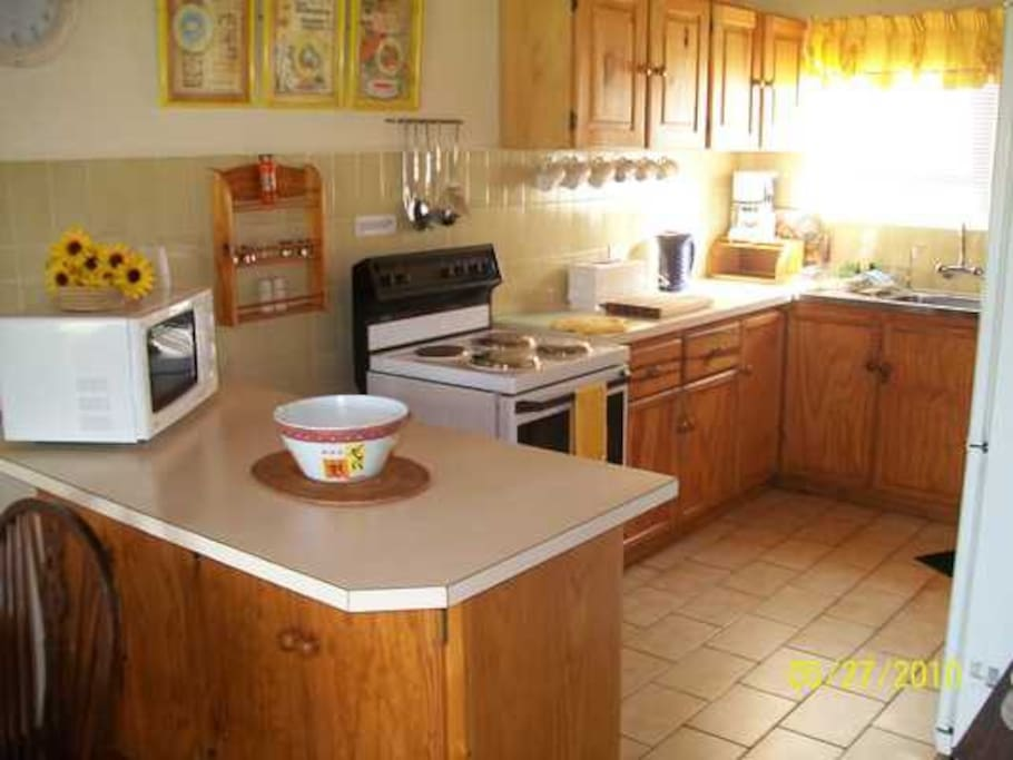 Fully equipped kitchen with stove, microwave, full size fridge, all the pots and pans and utensils you might need.  Outdoor BBQ.