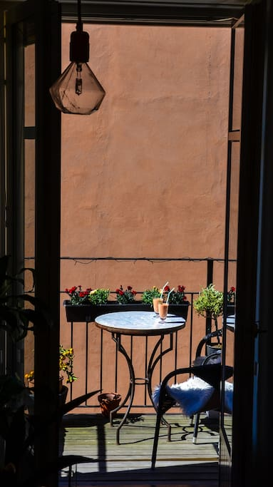 Enjoy, breakfast, lunch, dinner or some drinks in our sunny cozy balcony