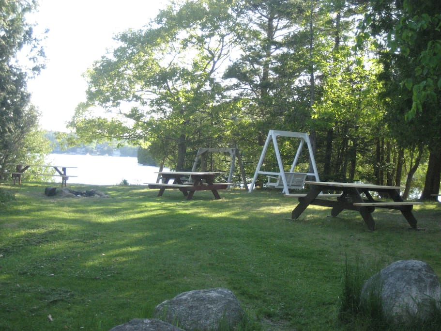 Assn. picnic area with swing, fire pit on water