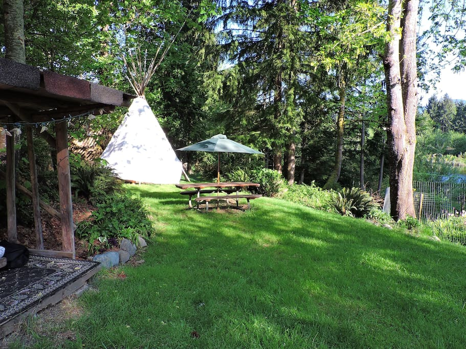 The tipi in its new garden location, closer to amenities...shown also are the meditation hut and picnic table...you can see the pond just beyond the tree