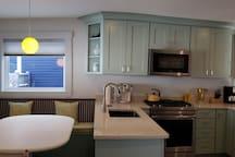 Beautiful new kitchen with quartz countertops.