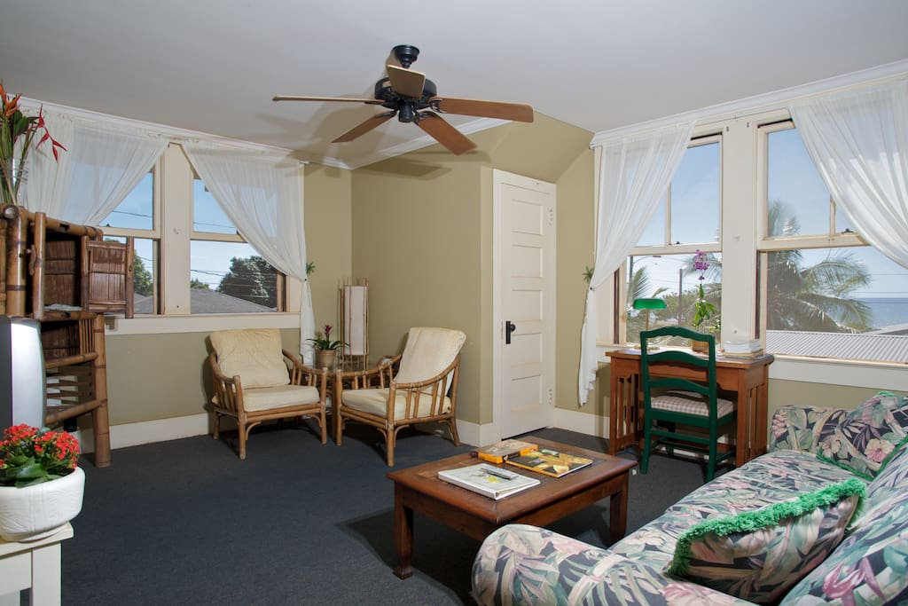 Relax in the ocean view living area with TV, couch, and tradewind breezes off the ocean