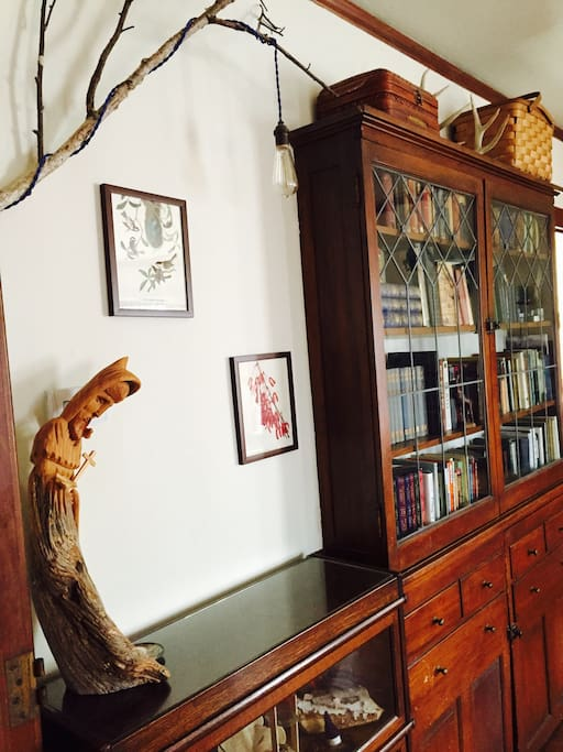 Hand-crafted Birch Tree Lamps & a well-stocked Leaded-Glass Bookcase.