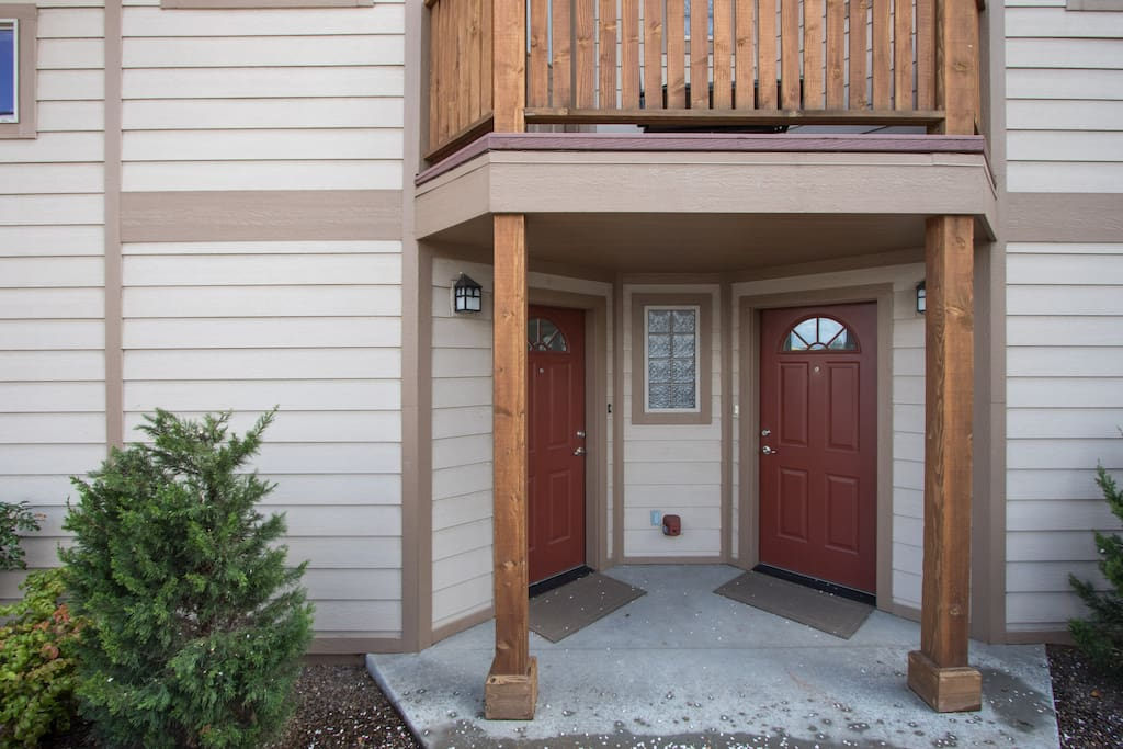 There are separate front entrances for the apartment and the house.