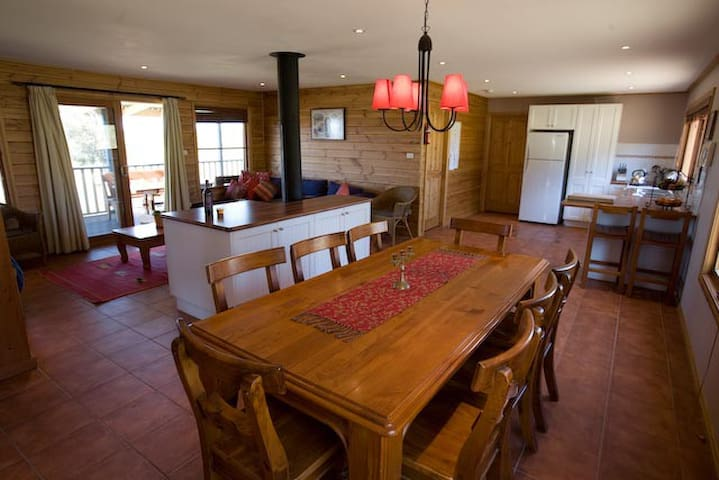 Mountain cottage main lounge/dining/kitchen with log fire.