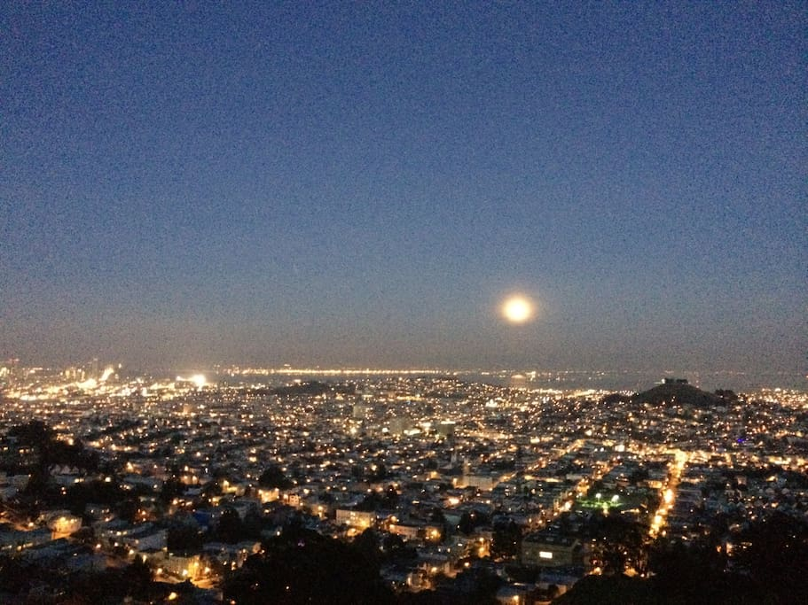 At night the moon rises and the planes line up in the distance for SFO and Oakland airports