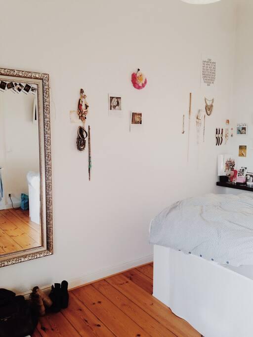 bedroom plus big mirror
