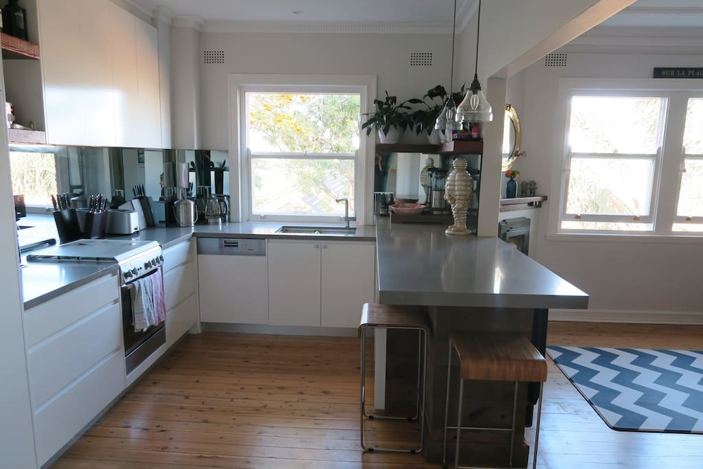 Recently renovated, beautifully appointed kitchen featuring gas stove, dishwasher and big fridge/ freezer. Watch the water from the breakfast bar.