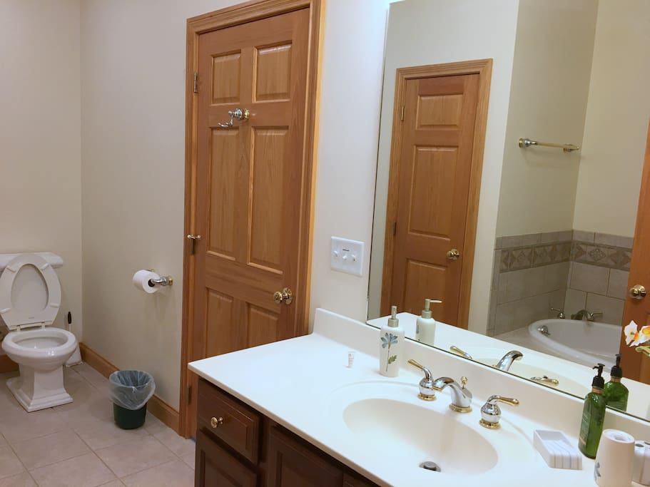 Attached bath with soaking tub and shower