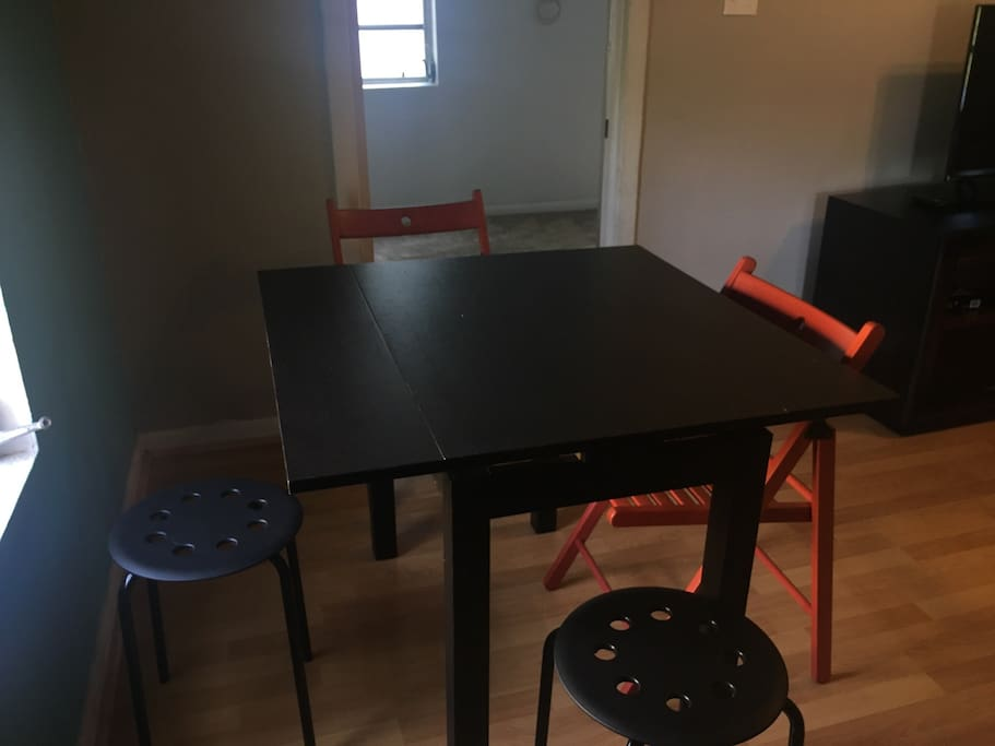 Table extends to accommodate 4 guests.