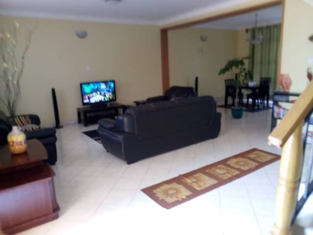 The living room, fully furnished with dstv and WiFi plus a home theatre