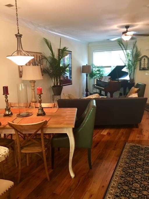 Dining and living area. Yes, feel free to play the baby grand!