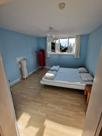 there are two single mattresses in one bed frame. The room is bright and spacious.