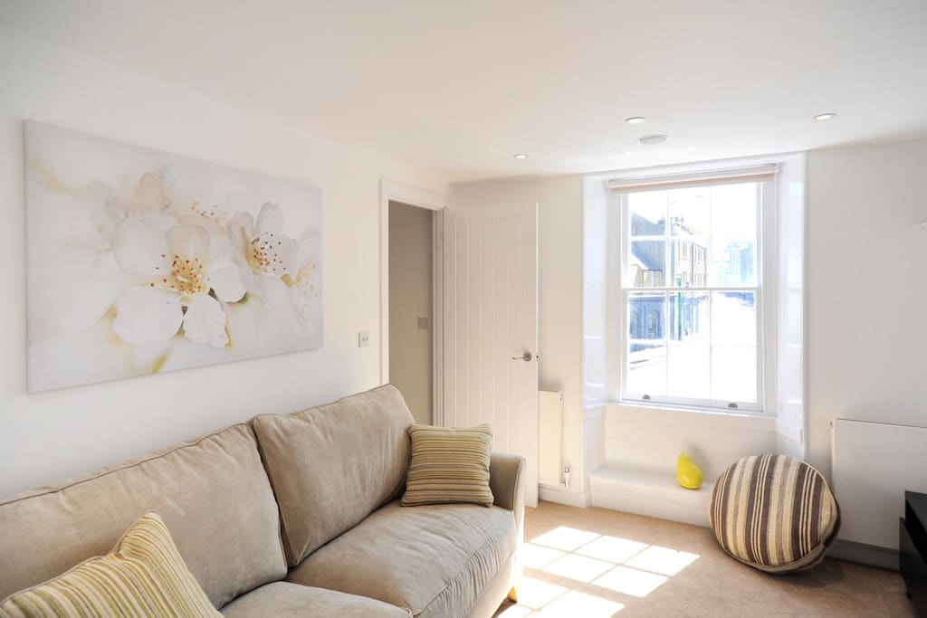 Read, watch TV, play music or play games. A bright room with a lovely comfy sofa to relax on.