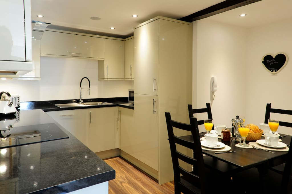 Fully fitted kitchen with a dining area. We have provided everything you need to cook for yourselves if you don't want to eat out. Even a separate wine fridge.