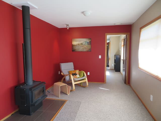 The corner next to the fire can be set up as a cosy sitting area, or...