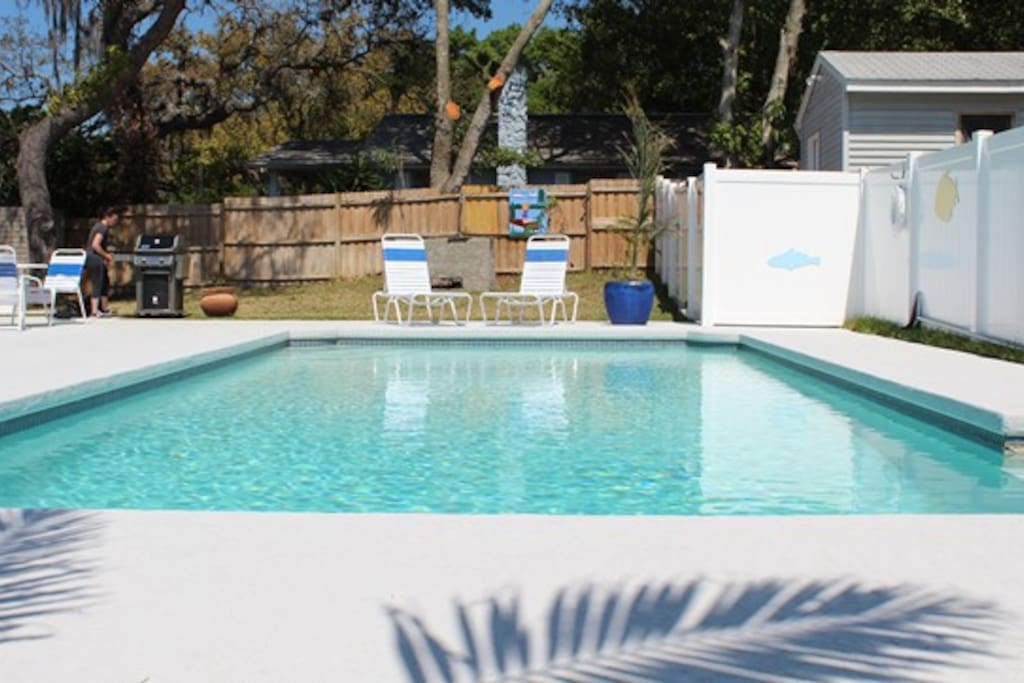 Fantastic pool, patio, grill, tables, and lounge chairs