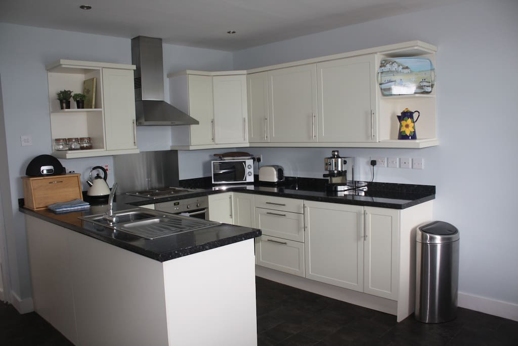 Fully equipped spacious kitchen with dining area
