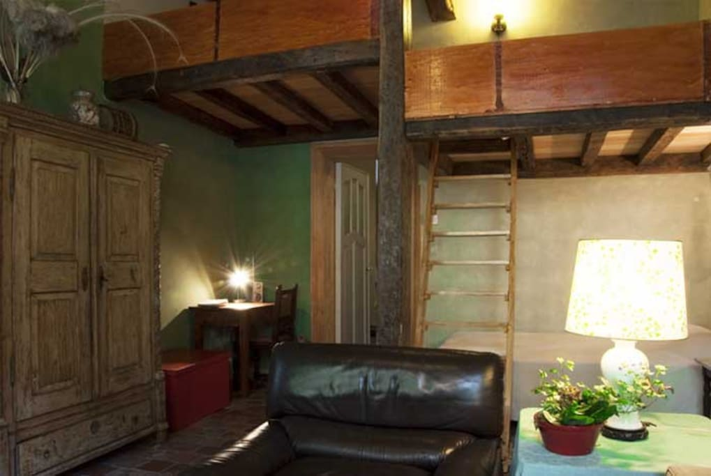 View toward sleeping areas and kitchen door