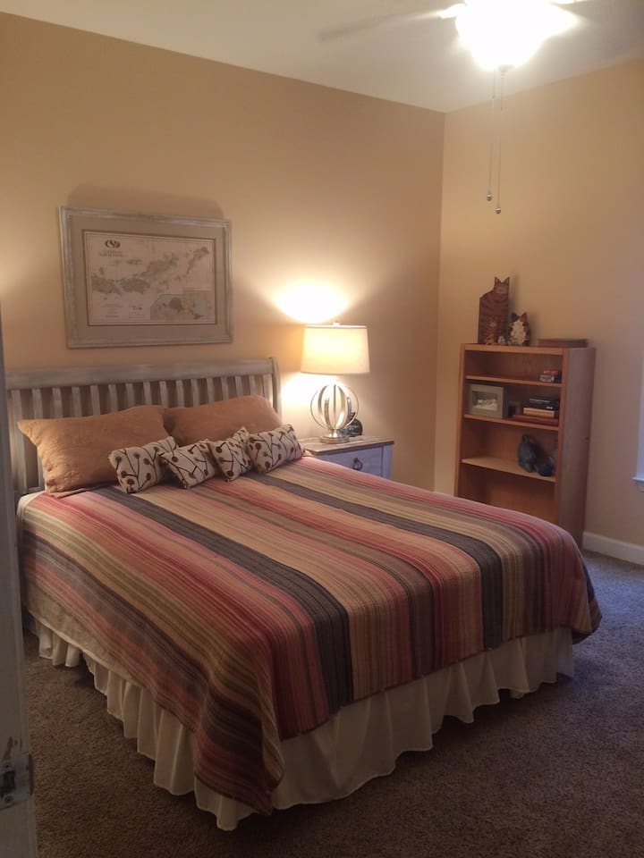 very comfy bed, ceiling fan and large window in room