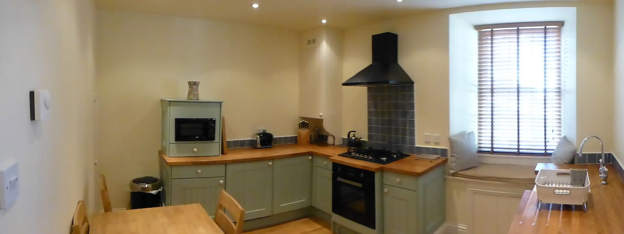 Beautiful dining kitchen with dishwasher and washer dryer.