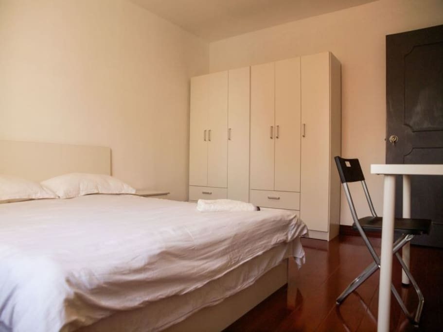 VERY spacious master bedroom with big wardrobe, study desk and a chair