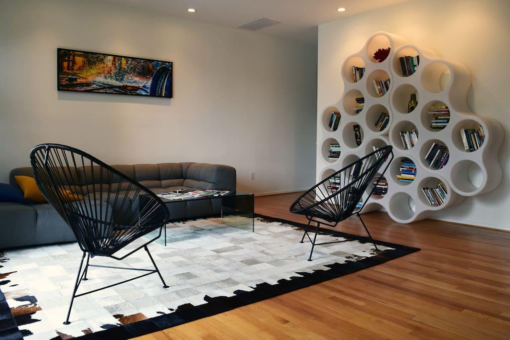 Living room.  Hip bookshelf n' stuff.oy