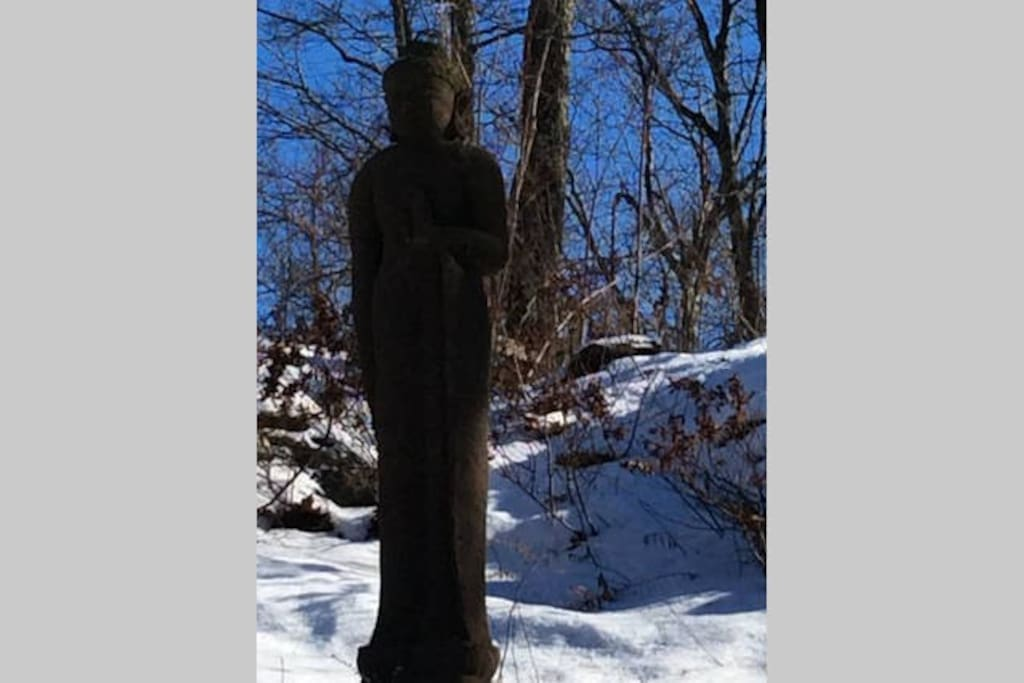 The Buddha that greets you as you drive up the one mile driveway