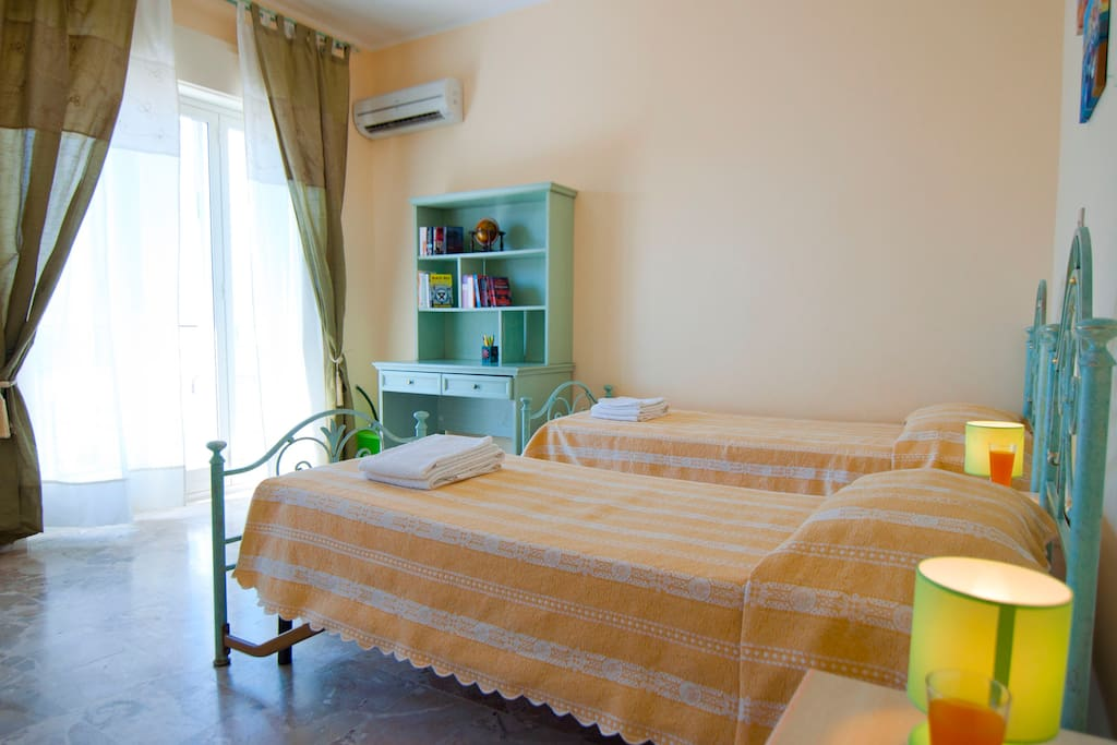 twin bedroom with large balcony seaview