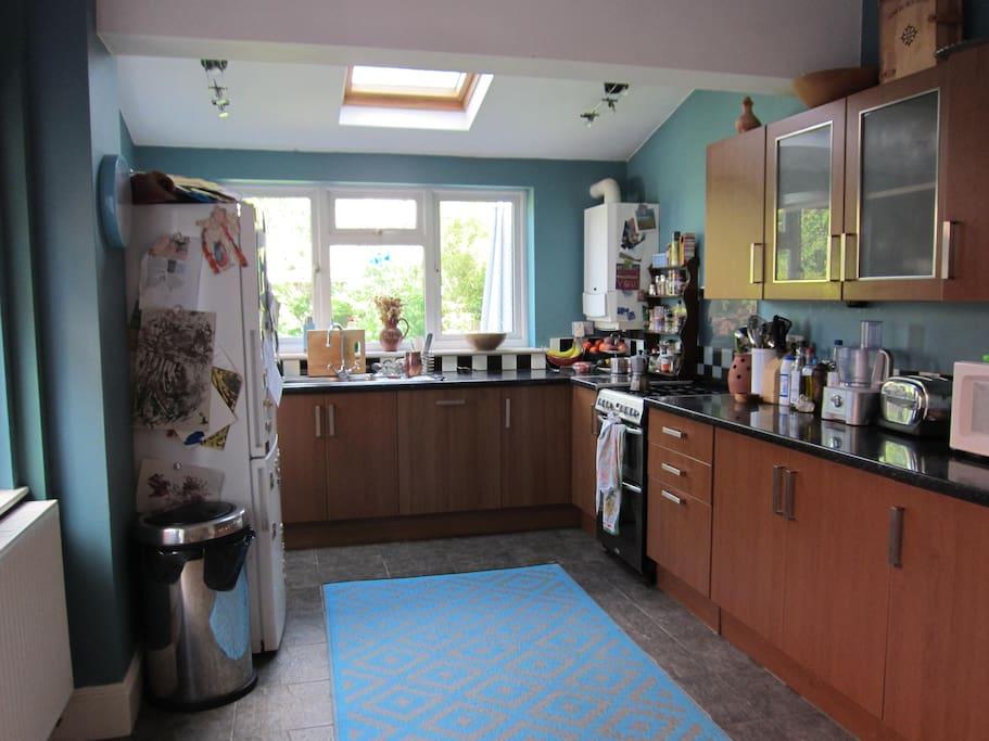 Large kitchen with washing machine, dishwasher and microwave