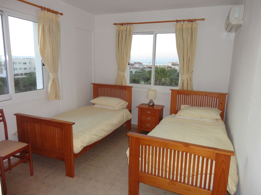 Bedroom 1 with sea view. All beds have duvets for winter lets.