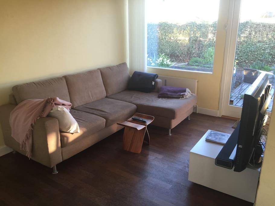 Living room – sofa and TV.