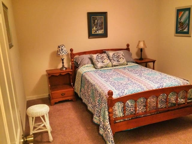 Ground floor bedroom with full-size bed and full private bathroom