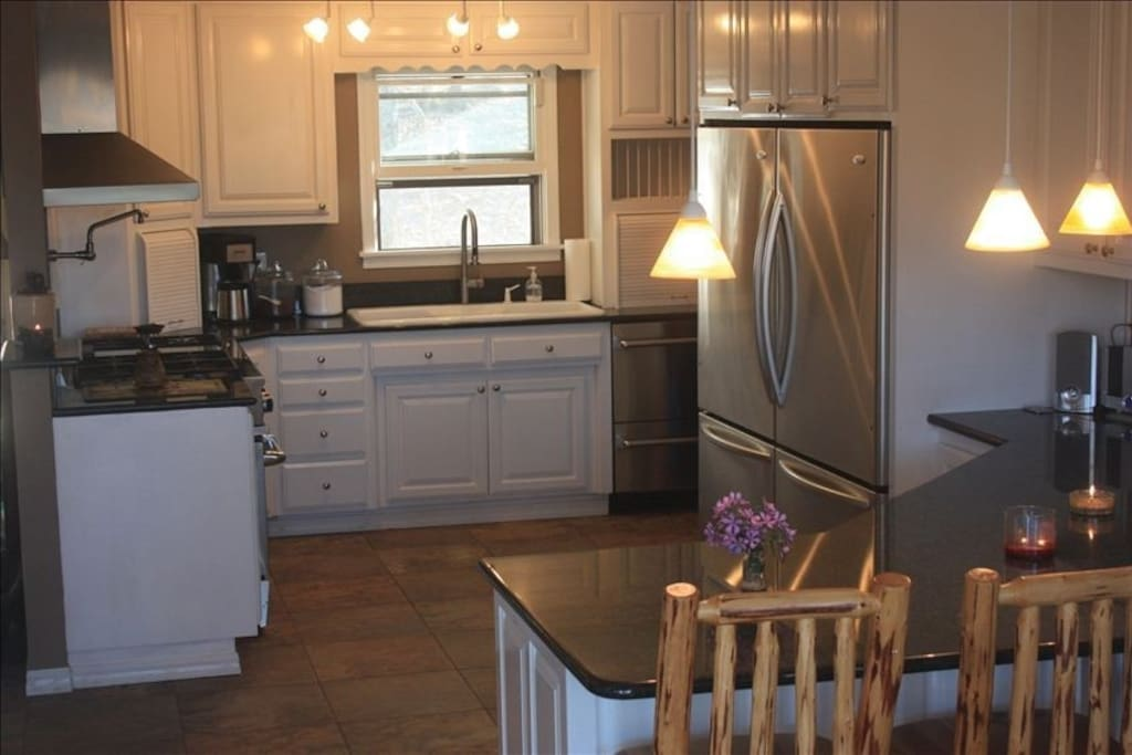 Gourmet kitchen that is open to the living room for easy entertaining.