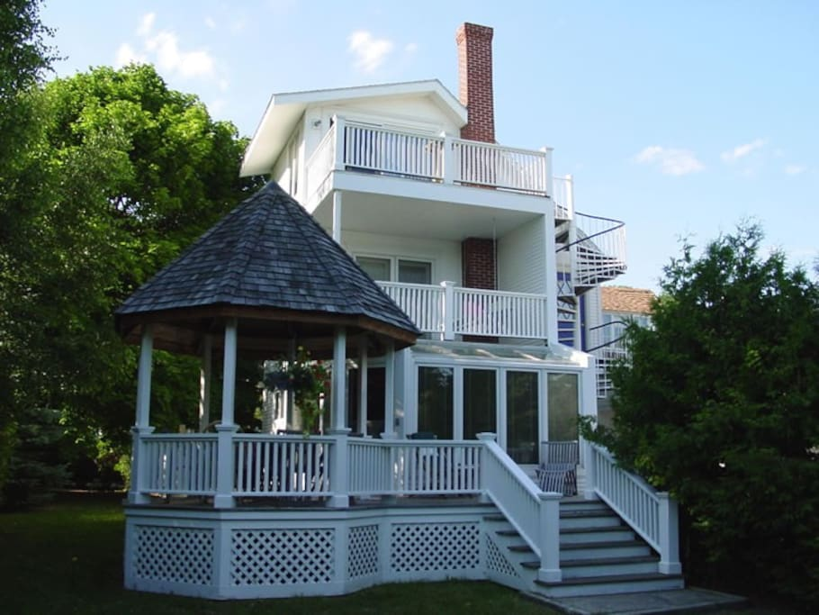 View of back of the house.  #rd story honey moon suite accessed by spiral stair case to right