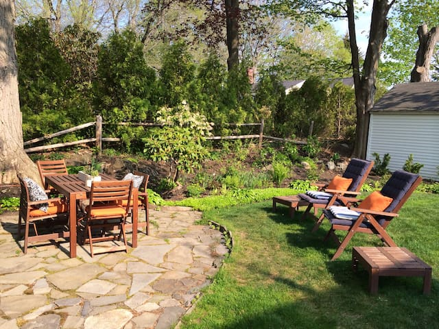 Backyard: Private yard with grill, gardens and dining area.