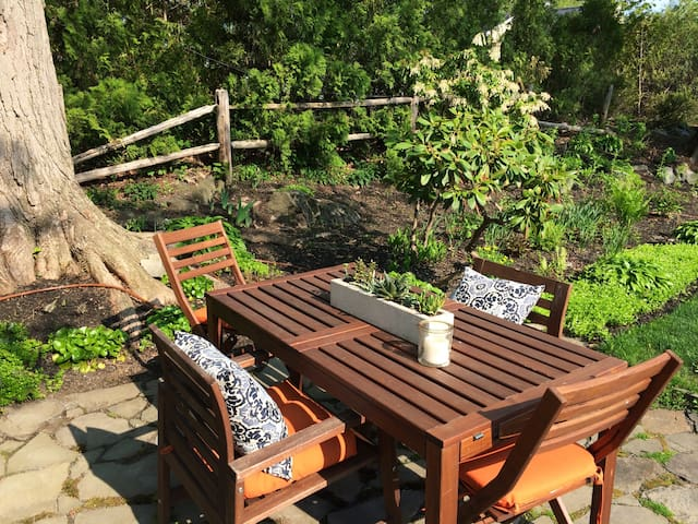 Private outdoor dining area,  surrounded by beautiful gardens.