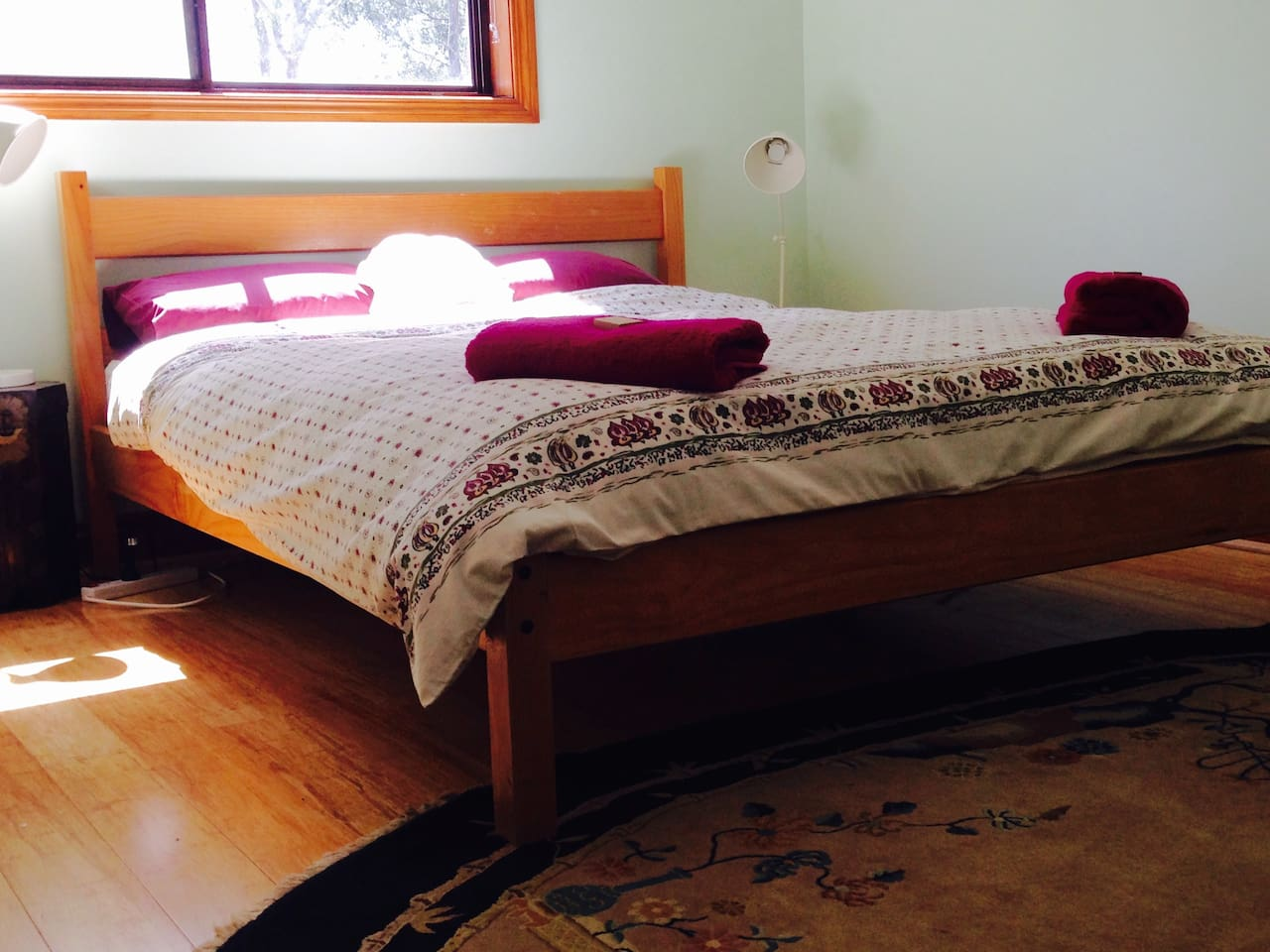 Main bedroom, looks out on to spacious grounds with native shrubs and trees