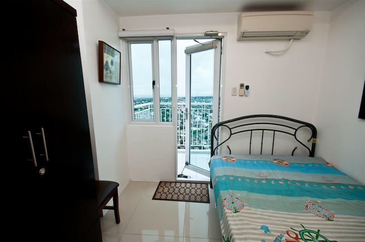 37F Furnished 1BR w/ Balcony & Wifi - Quezon City