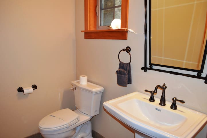 Upper entry level 1/2 bathroom in hall