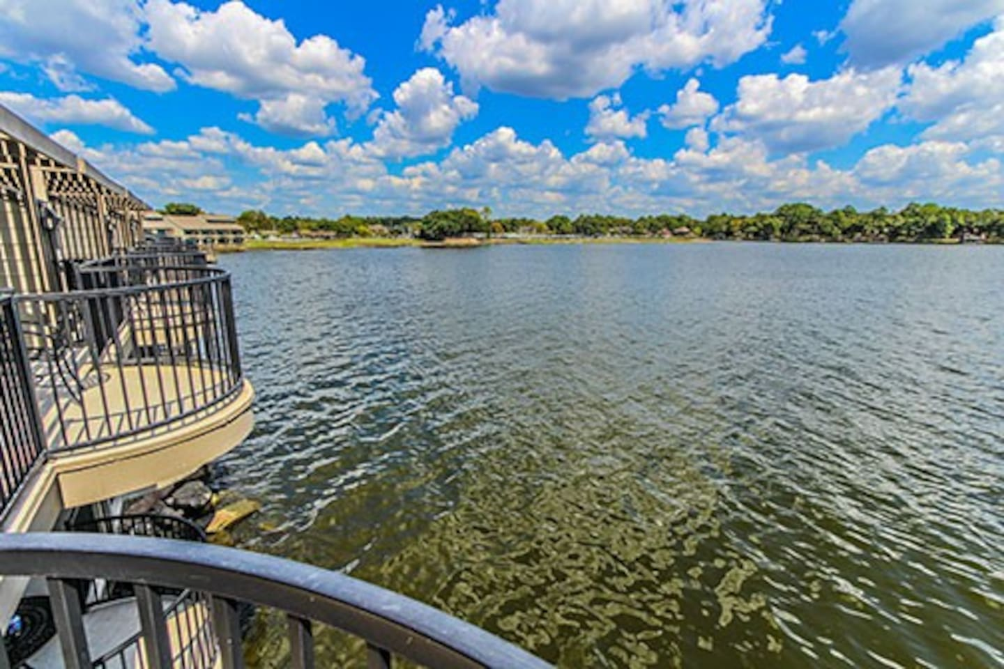 Enjoy Lake Conroe while lounging from your own private over the water balcony with sunrise facing view!